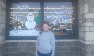 QHS Art Students Paint Brookshire's Windows with Winter Scenes