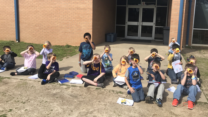 FIRST GRADERS are out spying for adjectives on a beautifully, sunny day!